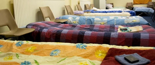 A row of beds at one of our host churches